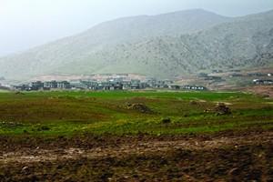 """Городок """"Савра"""" (участок на первом плане) будет соседствовать с христианской деревней (на заднем плане)"""